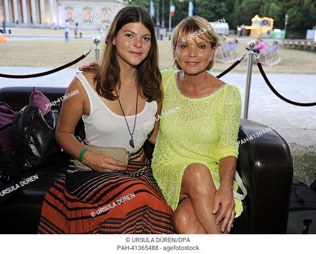 Actress Uschi Glas (R) and her daughter Julia smile before the premier of the film classic 'Zur Sache Schaetzchen' ('To the point darling') which is screened...