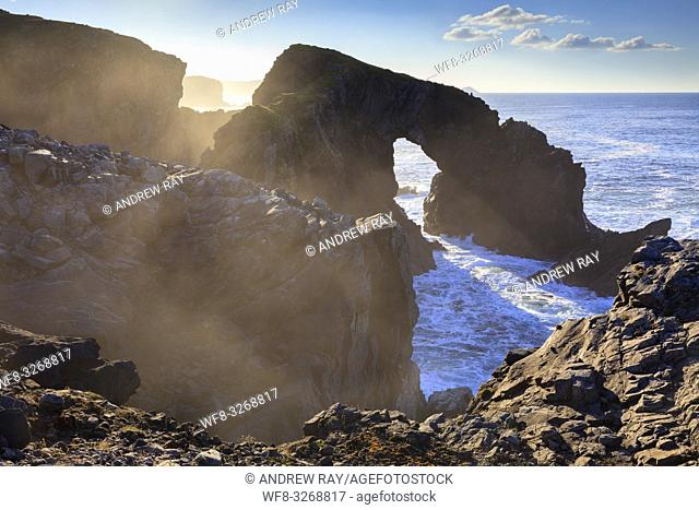 The natural sea arch at Stac a' Phris on the Isle of Lewis captured from the cliff top on an atmospheric afternoon in late October