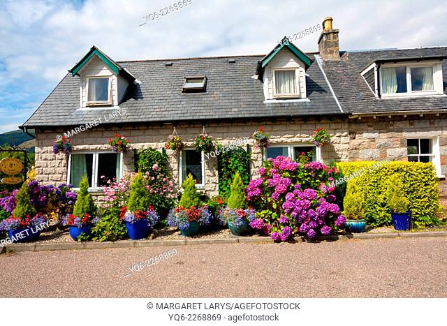 Beautiful house and flowers in the village of Glencoe, Scotland