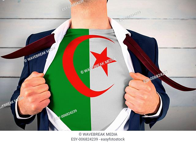 Composite image of businessman opening shirt to reveal algeria flag