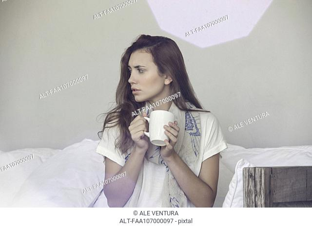 Woman enjoying hot beverage