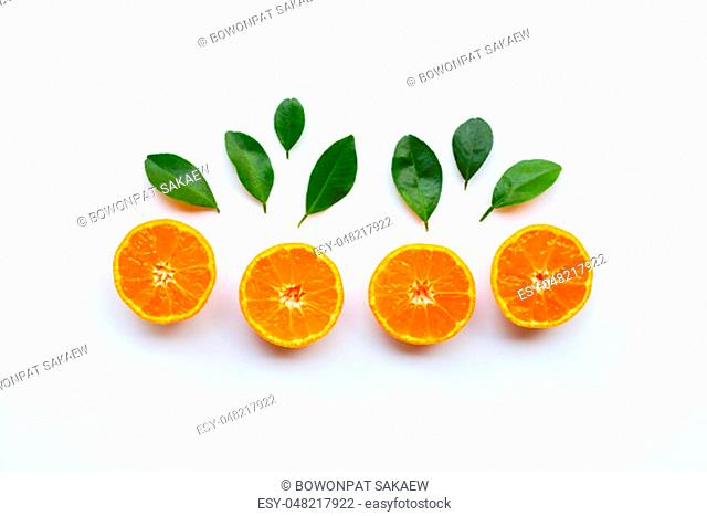 Orange fruits with leaves on white background. Top view