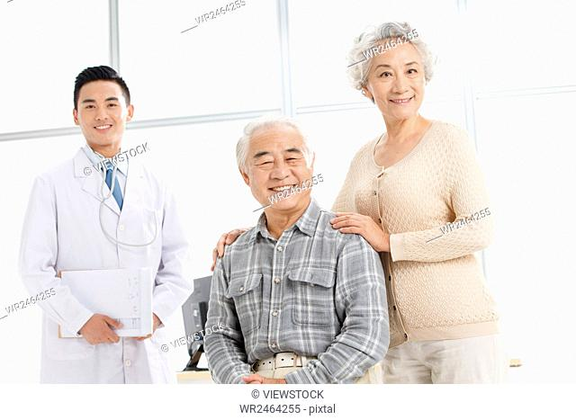 Senior couple in hospital with doctor
