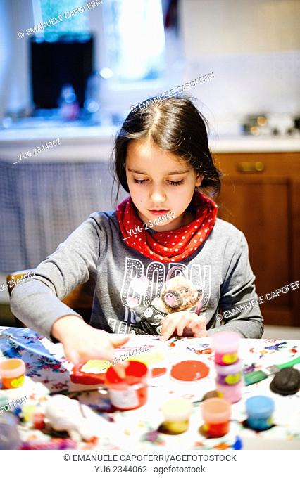 Child paints with his hands