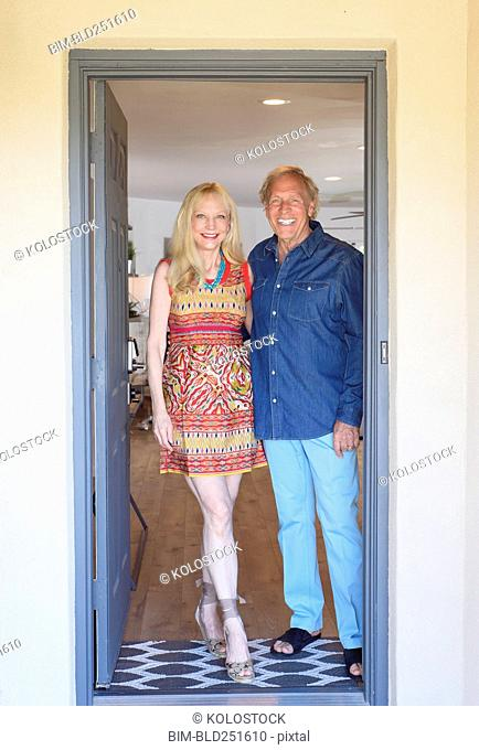 Caucasian couple posing in doorway