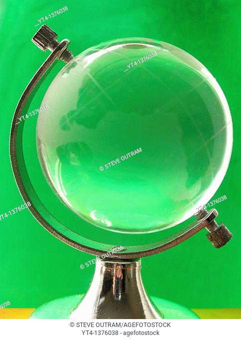 Small Glass Globe with Green Background  Protect the World with a Green Environment