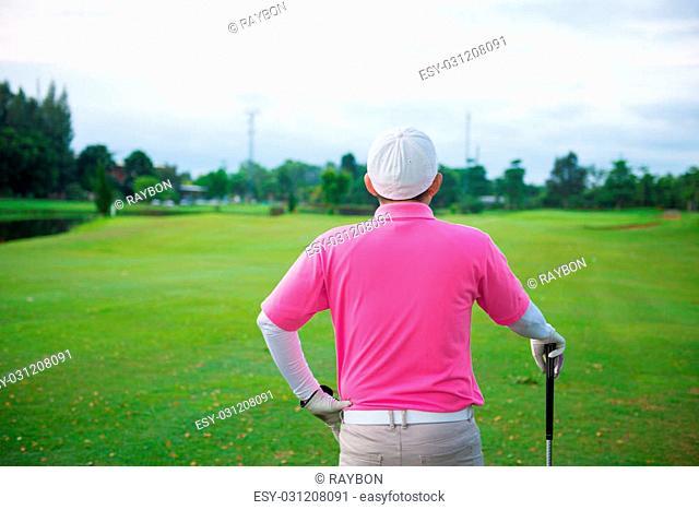 Golfer hits an fairway shot towards the club