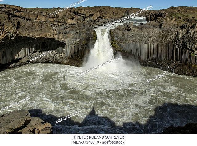 Iceland, highlands, Aldeyjarfoss with basalt columns, roaring spray, blue sky