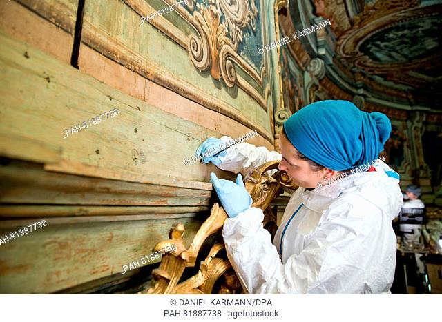 Conservator-restorer Friederike Labahn pictured during restoration work on the Margravial Opera House in Bayreuth, Germany, 24 May 2016