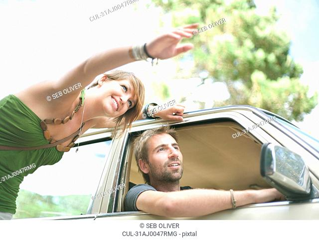Young woman giving directions to man