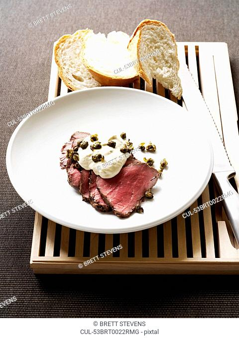 Plate of veal fillet with capers