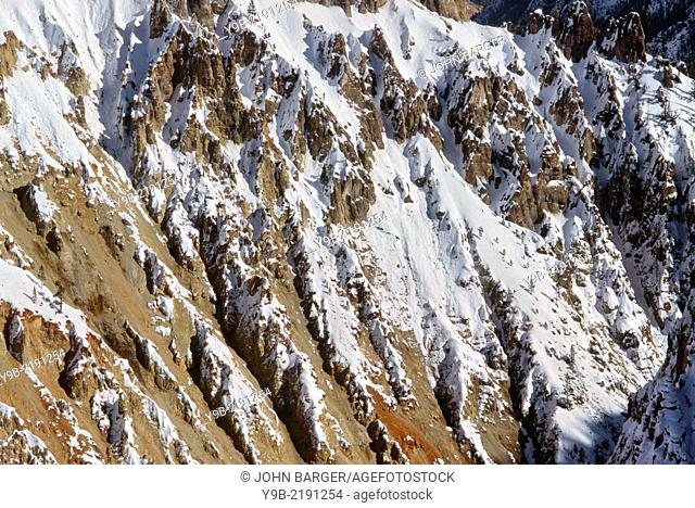 Winter snow on steep rhyolite cliffs, Grand Canyon of the Yellowstone,Yellowstone National Park, Wyoming, USA