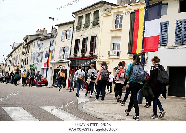 German students walk through Verdun, France, 28 May 2016. The memorial celebration for the 100th anniversary of the battle between German and French troops