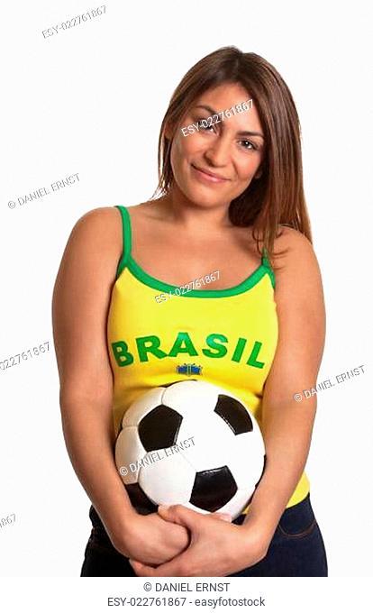 Smiling brazilian girl with football