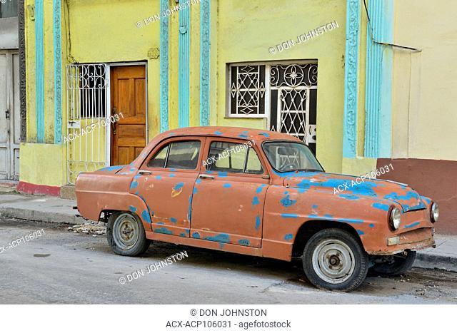 Street photography in Central Havana- Parked 'Yank Tank'on sidestreet
