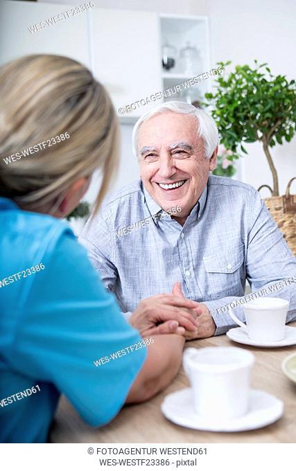 Gereatric nurse listening to elderly patient