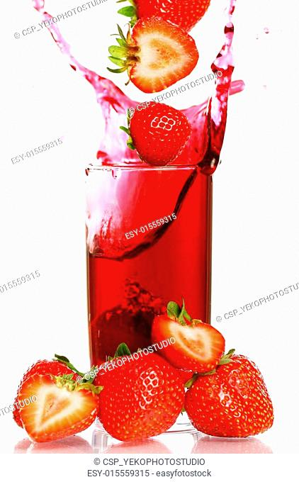 Strawberry falling into the glass