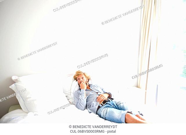 Man relaxing on bed