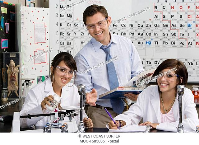 Science Teacher Helping Student