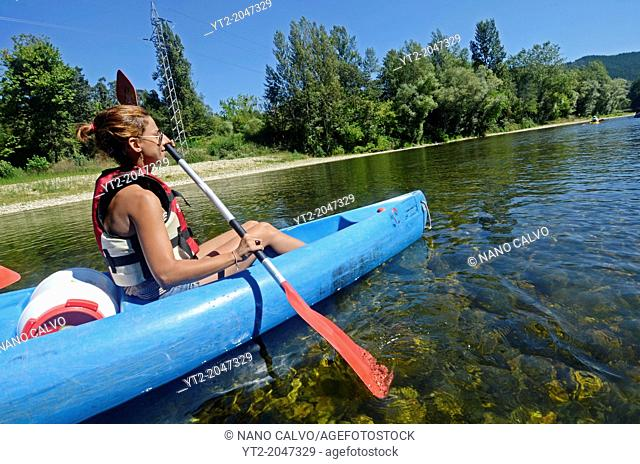 Young woman kayaking in Sella River, Asturias, Spain