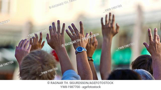 Hands waving cruise ship, Bergen, Norway