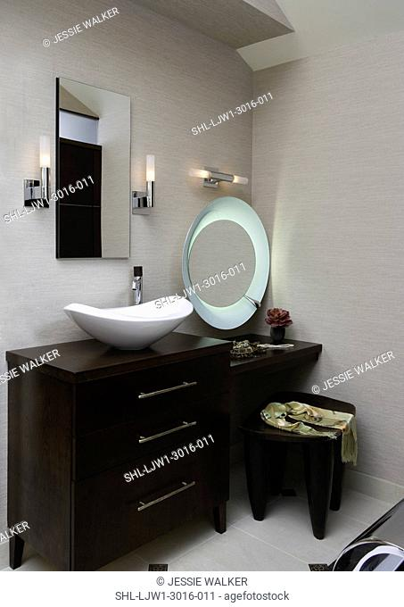 MASTER BATHROOMS: furniture style cabinets with bowl sink, dressing table with moveable frosted edge mirror, jewelry, scarf on wooden bench