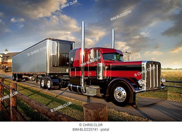 Semi-truck driving on rural road