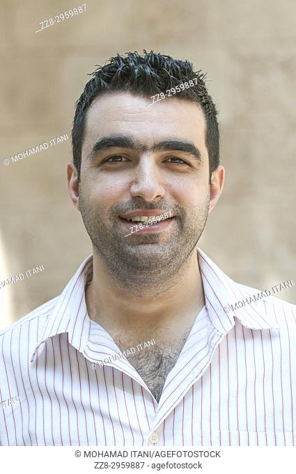Happy Lebanese man smiling outdoors