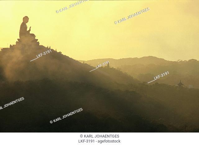 Statue at dusk, Po Lin monastery, Lantau Island, Hong Kong, China, Asia