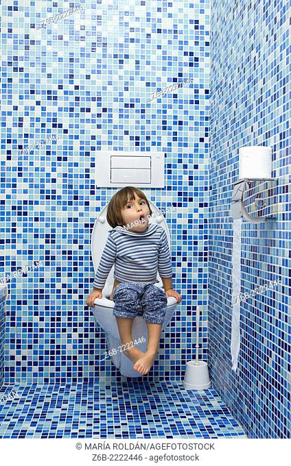 3 years old little girl in the toilet room