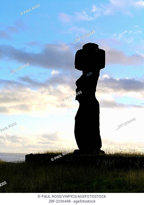 A re-created moai (ancestral spirit sculpture) sits at the traditional site of Ahu Tahai on Easter Island, Chile. Constructed of lava rock with a head-piece of...