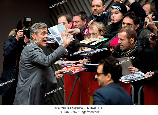 The actor George Clooney (L) attends the photocall for 'The Monuments Men' during the 64th annual Berlin Film Festival, in Berlin, Germany, 08 February 2014