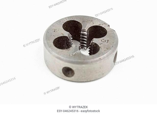 Device for making threads in a screw. Metalworking accessories. White background
