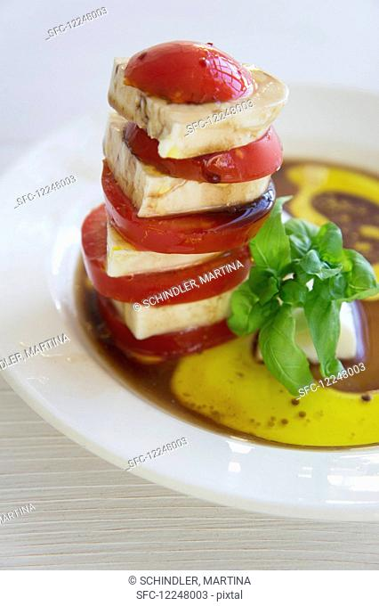 A stacked mozzarella and tomato salad