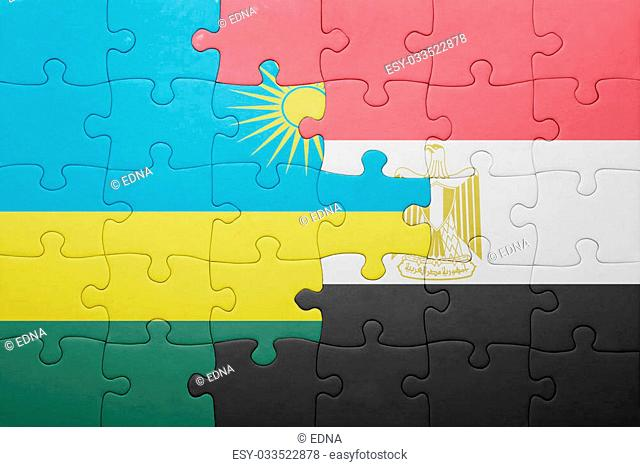 puzzle with the national flag of rwanda and egypt. concept
