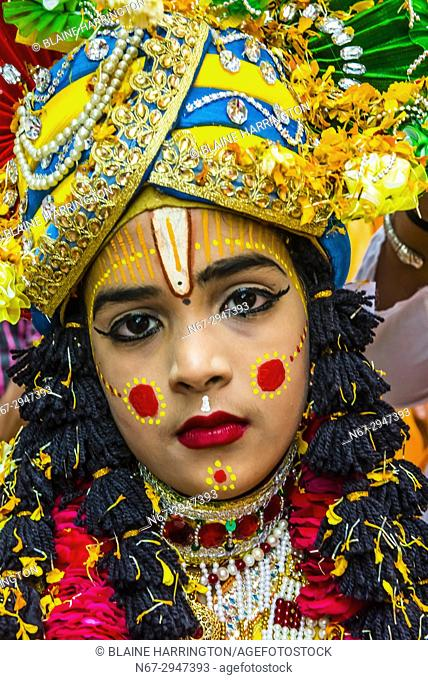 Boy dressed as Lord Krishna, Chhadi Mar Holi (one of the local Holi festivals in the Mathura area), Gokul, Uttar Pradesh, India