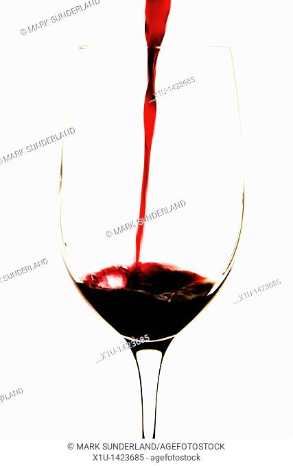 Pouring Red Wine into a Tasting Glass