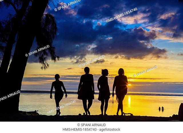 France, Ile de la Reunion (French overseas department), Saint Paul, beach and lagoon of Hermitage, silhouettes of bathers at sunset under the casuarinas