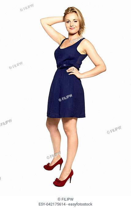 Cheerful young blonde woman in navy blue dress isolated on white background