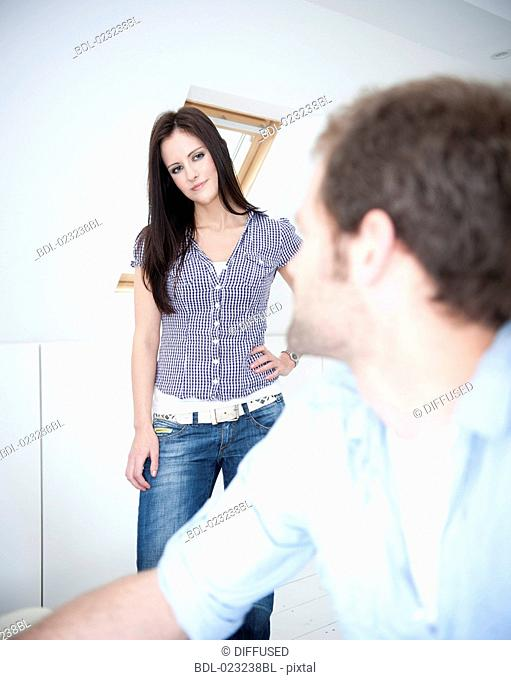 young couple at home looking at each other