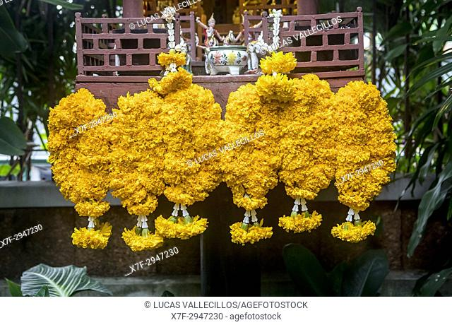 Flower offering at the temple of Jim Thompson House and museum, Bangkok, Thailand