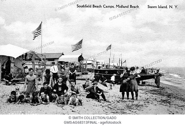 Postcard of people in early 20th century bathing costumes on sand, sailing boat, cottages and flags, titled Southfield Beach Camps, Midland Beach Staten Island