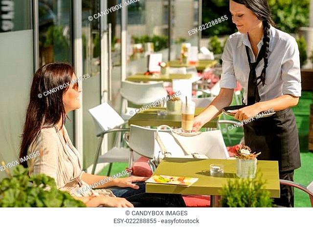 Waitress serve woman latte at cafe bar