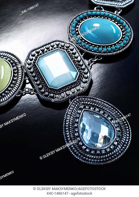 Pendant necklace jewellery isolated on black background