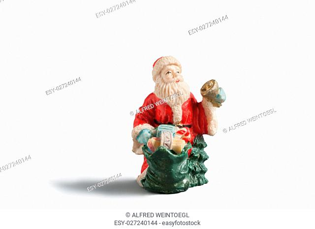 Figure of father frost with a golden bell