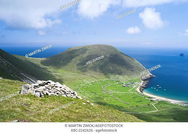 The islands of St Kilda archipelago in Scotland. Island of Hirta with village bay and the settelment abondoned 1930, Cleit traditional bothy in the foreground