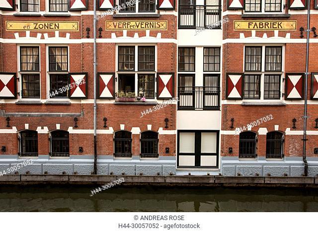House facade of the old Ver Vernies Fabriek at Oudezijds Kolk Canal, Amsterdam, Holland, Netherlands