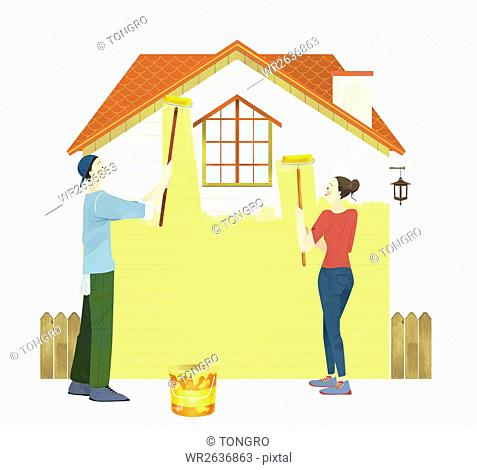 Smiling couple painting house together