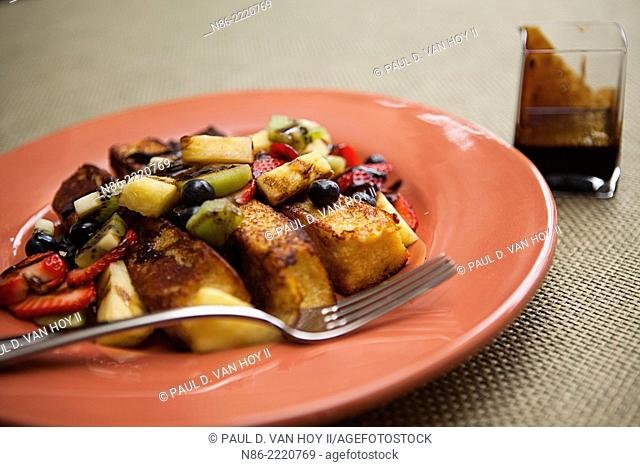 parmesan french toast with cut fresh fruit and balsamic caramel sauce
