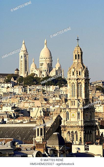 France, Paris, overview of Basilique du Sacre Cœur Sacred Heart Basilica and the Sainte Trinite Holy Trinity Church